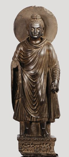 Standing Buddha, 2nd–3rd century, Schist H. 55 1/8 x W. 18 7/8 x D. 7 1/2 in. (140 x 48 x 19 cm). Lahore Museum, G-381. Loaned to Asia Society, NYC. [entry by LH, 30 March 2014].