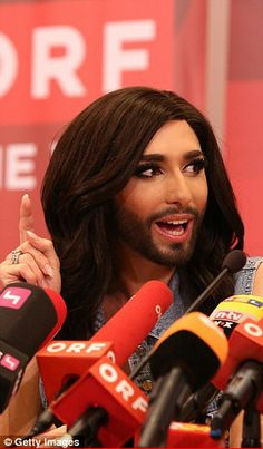 Speaking to her public: Conchita is interviewed by Austrian TV and radio at the press conf...