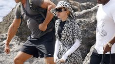 Just days after her 56th birthday, Madonna hit the beach in a long-sleeve ensemble that left everything to the imagination.