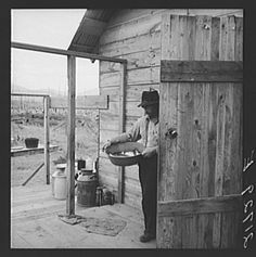 """New settler shows fish he caught this morning. He """"likes it fine here."""" Priest River Valley, Bonner County, Idaho. See general caption 54"""