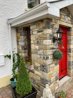 How cute is this Donegal Sandstone porch? With the red door! Check out our page for more inspo for your home project! Limestone Paving, Cottage Renovation, Stone Veneer, Donegal, Home Projects, Natural Stones, Porch, Building, Check