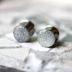 "Silver Glitter Ear Plugs, Sparkly Silver Ear Gauges, Resin Gauges, Plugs for Women - sizes 0g, 00g, 7/16, 1/2, 9/16, 5/8, 3/4, 7/8, 1"" on Etsy, $22.00"