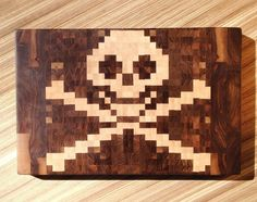 Pirate End Grain Cutting Board by 1337motif: 8 -Bit Pixel Art Inspired! Made of walnut and hard-maple, put together with FDA approved, water-proof glue, and treated with a mixture of mineral oil and beeswax. via wired  #Cutting_Board #Pirate