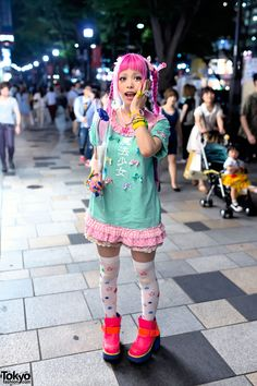 """Haruka Kurebayashi is a Japanese Kera Magazine model who we often see around Harajuku. Her look here features a pink braids and green shaved stars hairstyle with a """"Magical Girl"""" dress, star tights, and neon #YOSUKE platform shoes. #tokyofashion #streetsnap"""