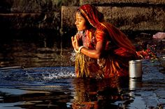 Indian woman in the river Ganges