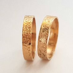 Wedding Band Rings, 14k Gold Rings, Timeless Rings, Campo di Fiori Collection, Bridal Jewelry, Unisex Rings, Handmade Rings, Venexia Jewelry. These classically unique wedding bands are handcrafted in 14K yellow gold, reflecting the warm radiance of your timeless love. A beautifully unique symbol of your commitment, these rings will continue to delight as the years go by. Each 14K yellow gold band is handmade to order featuring a pattern artisan finish. His ring is bold and masculine and is…