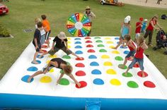 I totally want to rent this for a summer party. Inflatable Twister! How awesome!?