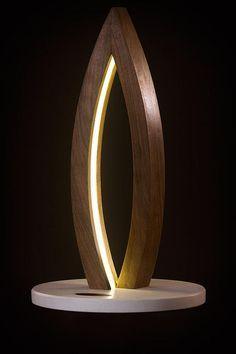 unique led lightning for interiors and gardens http://www.urbanforest.co.nz/ Piotr Fox Wysocki, led,bent wood, lamp, light sculptures, black walnut, hand made, art, modern design, moonlight, New Zealand, rna, dna, flame, wave