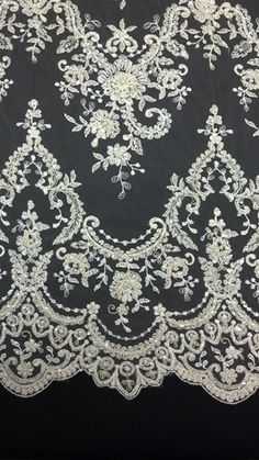 Double scalloped, embroidered floral design, with pearls, beads, and sequin