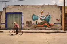 AEC who makes up half of the Ukrainian mural duo, Interesni Kazki, painted multiple murals while visiting Cholula, Mexico. The artist also teamed up with Mexico City-based muralist, Saner, for a joint collaboration.  These particular pieces look that much better and add a lot of life to the old dilapidated walls.