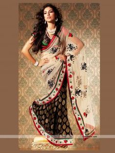 This white and black designer half-n-half saree will definitely give you glamorous look. Beautiful black embroidery looks attractive on white shade. Perfect selection or kitty or small parties. http://goodbells.com/saree/designer-black-and-white-shade-saree.html