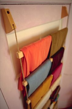 A rope ladder could hold fabrics, handmade paper, necklaces, rope candles, ect, and could also be made to hang from a canopy to bring things up to eye level.