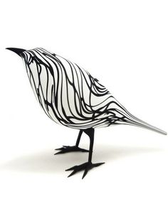 Zebra Finch, Flame-worked & acid etched glass, by Shane Fero, an American artist and glass blower