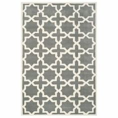 Wool rug in grey with a trellis motif. Hand-tufted in India.   Product: RugConstruction Material: 100% WoolColor: Dark grey and ivoryFeatures:  Made in IndiaHand-tufted  Note: Please be aware that actual colors may vary from those shown on your screen. Accent rugs may also not show the entire pattern that the corresponding area rugs have.Cleaning and Care: Professional cleaning recommended
