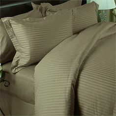 "SOHO Egyptian cotton 500 Thread Count Sateen Stripe 4 Pc Comforter Set - Linen CalKing. by Vanessa Collection. $151.99. Sleep in luxurious 300 thread count comfort with this down alternative white comforter.. Imported.. 100% Egyptian cotton. CalKing set measures 106"" W x 92"" L and includes two king shams 20x36"" each.. Soho 4 pcs duvet cover and comforter. Product Description Luxury 4-PC Egyptian Cotton Down Alternative comforter set: The Ultimate in Luxury this 4-pc Set in..."