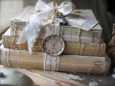 Miss Rose Sister Violet: Archive - stack of old books tied with lace ribbon, clock face for interest