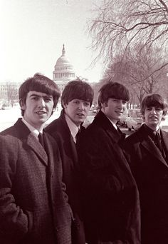 The Beatles posing in front of the US Capitol on the  day of their first concert in the US.  February 11, 1964.