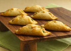 Crab-Filled Crescent Wontons-  These Asian-inspired appetizers start with flaky crescent roll pastry wrapped around a quick cream cheese and crab filling.