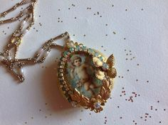 Vintage rococo locket ,Angel and wreath of rose,cabochon under glass ,rhinestones , Miriam Haskell elements, flowers and butterflies