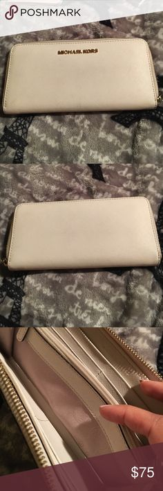 White/beige Michael kors long wallet White/beige Michael Kors wallet. Zips great, lots of little pockets in the interior. There are two very minor marks on the inside of the wallet which I've posted pictures of and a little hint of wear on the edge of the wallet so it's a bit darker-- which I also have a picture of. Please feel free to ask any questions! All items are from a smoke free home. Michael Kors Bags Wallets