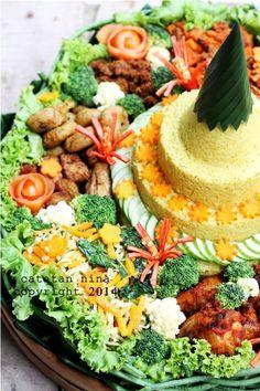 Java Indonesia food for celebration. TUMPENG NASI KUNING