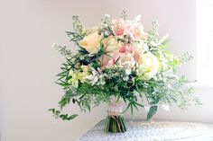 Loose peach bouquet by Bloomsday Flowers
