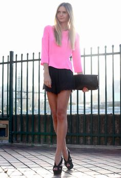 pink shirt / black dress shorts / black heels + clutch