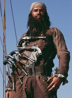 Blackbeard... known for pistols aplenty and burning slow match tied into his beard for demonic effect upon yard arm to yard arm boarding... it seems to have worked...