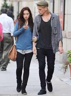 Budding romance: Lily Collins and Jamie Campbell Bower looked every inch the cute couple as they wandered arm in arm around Toronto earlier today
