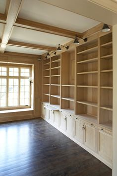 Would love this wall of shelves and cabinets