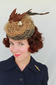 """Vintage-style tilt hat with vintage faux bird and abstract nest (made out of vintage veiling and vintage millinery berries as the """"eggs."""")."""