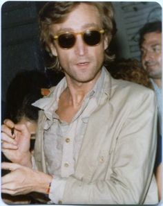 John Lennon signing autographs... moments before he was shot. We miss you