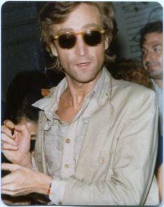 John Lennon signing autographs... 1980
