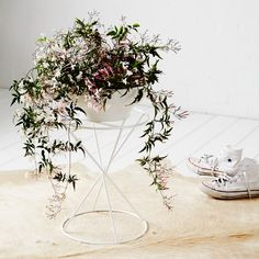 Ivy Muse Hourglass White Plant Stand now available online at Urban Couture. Designed with a steel metal frame.