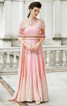 Buy Pink gown style anarkali suit with embroidered flare online in India at best price.ight pink raw silk net gown style anarkali suit Resham embroidered flare with embellished yoke Comes Indian Gowns, Indian Attire, Indian Wear, Indian Wedding Outfits, Indian Outfits, Indian Clothes, Abaya Fashion, Indian Fashion, Indian Gown Design
