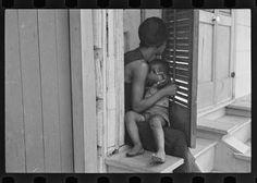 "Mother breastfeeding baby. ""Scene in New Orleans, Louisiana; Shahn, Ben, 1898-1969,  LC-USF33- 006099-M2"""
