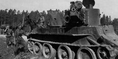 German soldiers with a knocked out BT-7 Artillery, 1941