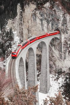 "Swiss Train - What a cool spot for a bridge. Let's come out from a cliff, over a large bridge, high above a creek!"" Why do it easy when you can put your engineering skills to use. Well done Switzerland. Places To Travel, Places To See, Train Wallpaper, Beautiful Places In Japan, Old Trains, Train Pictures, Train Journey, Model Train Layouts, Scenic Photography"