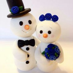 Snowman cake topper :) but silver/grey flowers