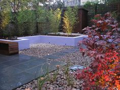 Low maintenance garden with Slate and Pebble surfaces by Modular Garden, via Flickr