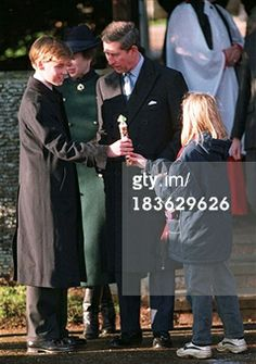 SANDRINGHAM - DECEMBER 25: Prince William receives a gift from a young admirer as he attends the Christmas Day church service without his mother Princess Diana on December 25, 1995 in Sandringham, England (Photo by Anwar Hussein/Getty Images)