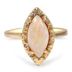 ethereal marquise-shaped natural opal cabochon glimmers in this spectacular Retro piece.