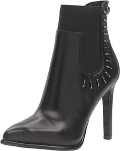 KENDALL + KYLIE Women's Cassidy Black Multi Dress Calf Bootie/Gore Shoe. The Cassidy pump bootie by KENDALL + KYLIE™ is edgy and sexy. Leather upper with metal detailing. Pull on construction with side goring. Pointed toe. Man-made lining. Lightly-padded footbed. Wrapped heel. Synthetic outsole. Imported. Measurements: Heel Height: 4 1⁄4 in Weight: 13 oz Circumference: 10 in Shaft: 6 1⁄2 in Product measurements were taken using size 9, width M. Please note that measurements may vary by size.