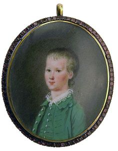 "Samuel Cotes ca.1760. Portrait of a young boy dressed in green jacket, waistcoat & lace shirt, signed with initials, set in gold frame with garnet border, the reverse with commemorative tree made of hair showing bottom branch broken. Oval, 1 3/4"" high. The tree on the reverse with broken branch suggests that the sitter in the portrait has recently died. The sitter is Cotes's only child who died in infancy, which might account for the lack of signature"