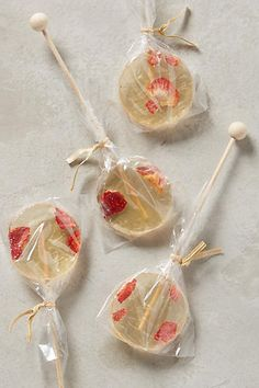 > > > Champagne & Strawberry Lollipops - would make good party favors for grown ups - Good goody bag treat idea!