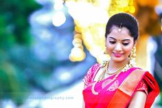 South Indian bride. Temple jewelry. Jhumkis.Pink silk kanchipuram sari.Braid with fresh jasmine flowers. Tamil bride. Telugu bride. Kannada bride. Hindu bride. Malayalee bride.Kerala bride.South Indian wedding.