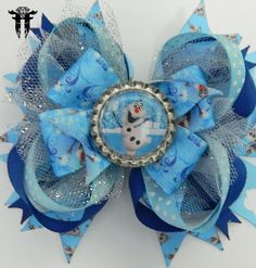 "*~*~* Frozen Inspired ""Olaf"" Hair Bow *~*~*            This super cute Olaf inspired hair bow measures approximately 5 x 5 inches!!  Stacked and stacked with printed grosgrain ribbon and shimmery tulle, it`s a perfect accessory for your Frozen fan! I have sealed Olaf in a bright white flattened bottle cap to the center of the bow. His portrait is protected by an epoxy dome that slightly magnifies the design- bringing it to life!"