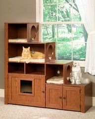 "old entertainment center turned into a ""cat habitat"" Neat idea!!"