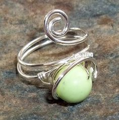 Sterling Silver Ring Lime Green Jade Wire Wrapped Free Form Gemstone earthegy. $25.00, via Etsy.