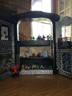 DIY Gotham city. Repurposed puppet stage. Super hero action figure house. (Doll house)